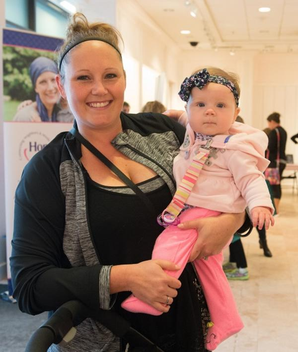 Woman holding a baby wearing pink