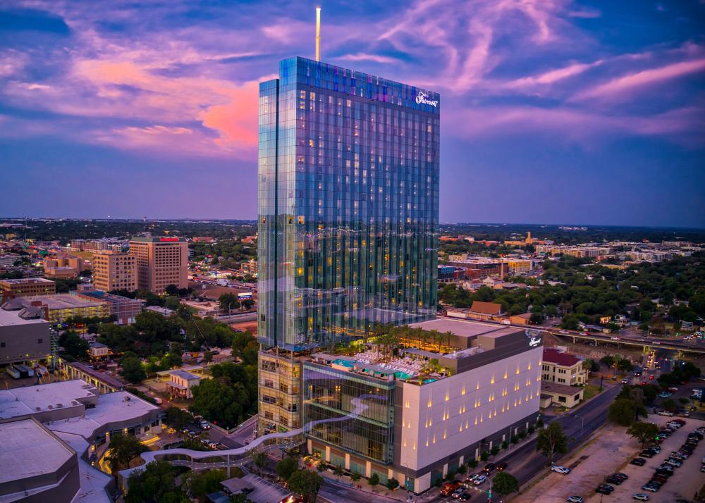 Exterior at sunset with skybridge and rooftop pool at the Fairmont hotel in Austin Texas
