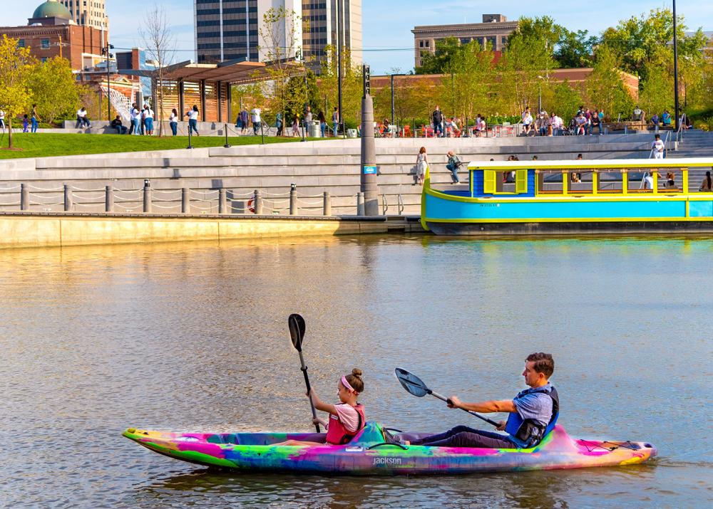 Dad and daughter kayaking on the St. Marys River at Promenade Park in Fort Wayne