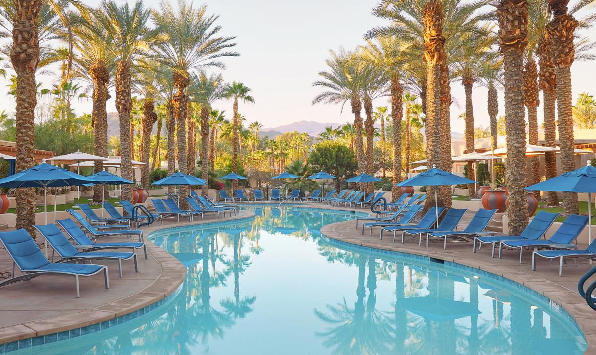 Pool surrounded by palm trees at Hyatt Regency Indian Wells