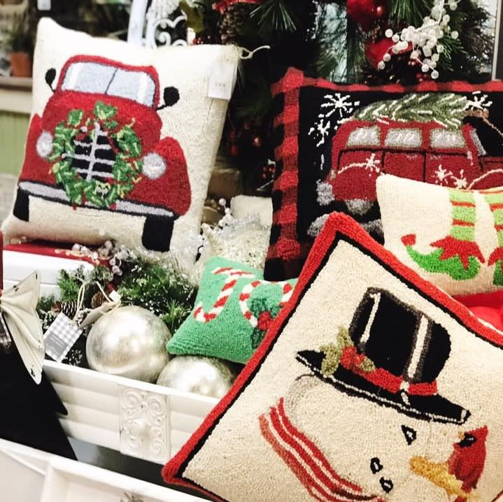 Photo of holiday and Christmas pillows and decorations at Gracie Lane