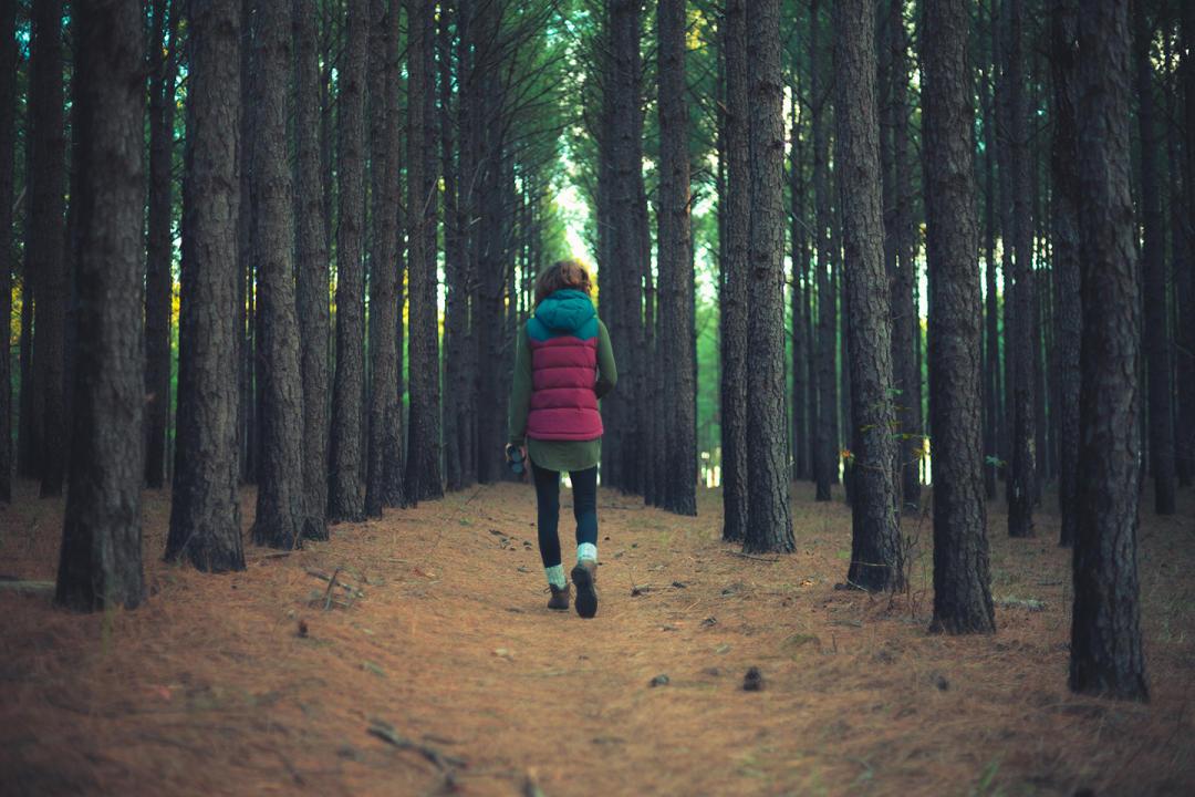 Woman walking through Bartram Forest near Milledgeville