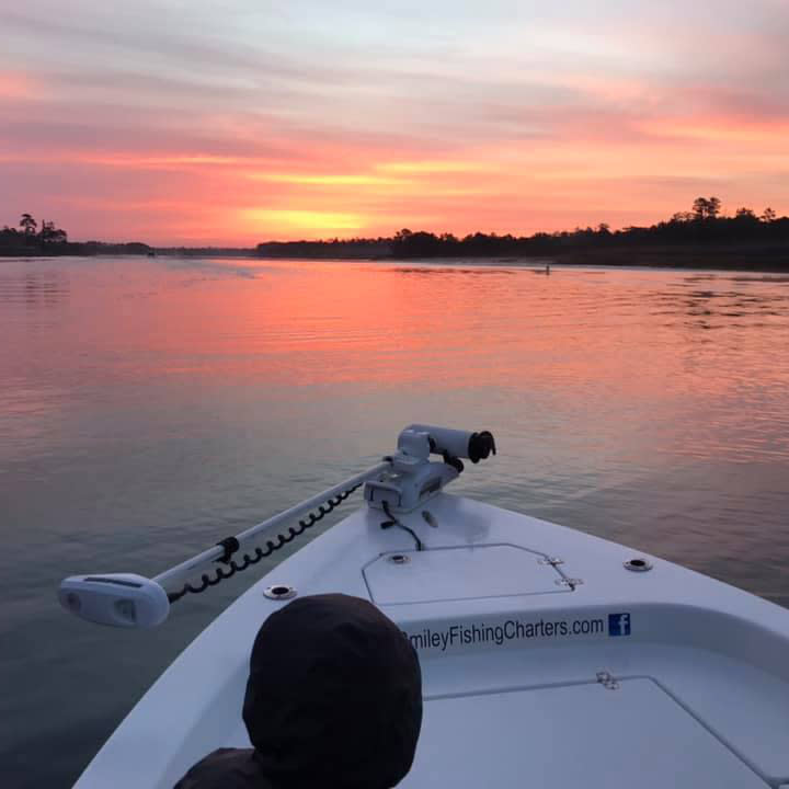 Sunrise and still waters start the fishing day at Captain Smiley Fishing Charters