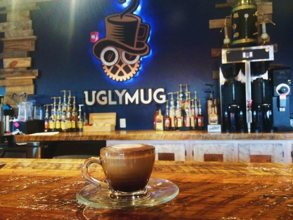 A cup of coffee on a saucer at the bar of UglyMug Coffee Shop in Johnston County, NC.