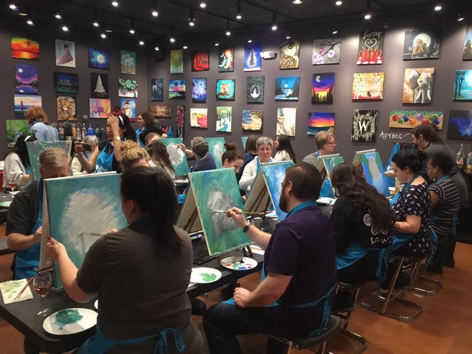 Pinot's Palette class of people painting
