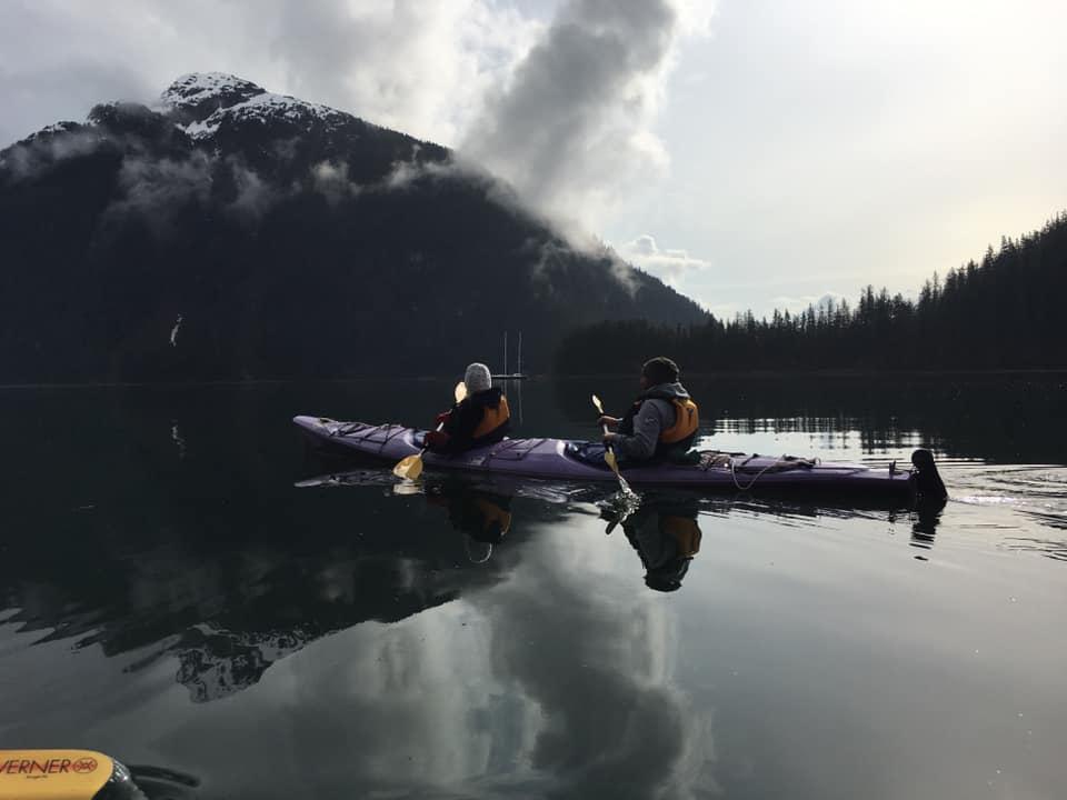 a tandem kayak in a remote bay