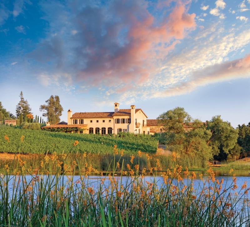 The Tuscan-style Krupp Brothers Winery sits on a grassy slope overlooking Lake Cynthia.