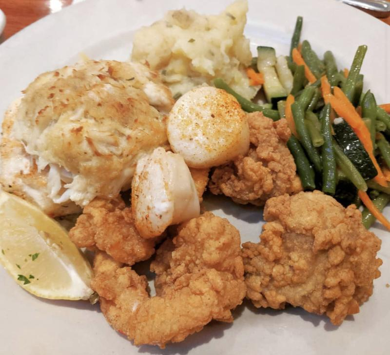 A plate features award-winning tempura shrimp and crab cakes from Blue Seafood