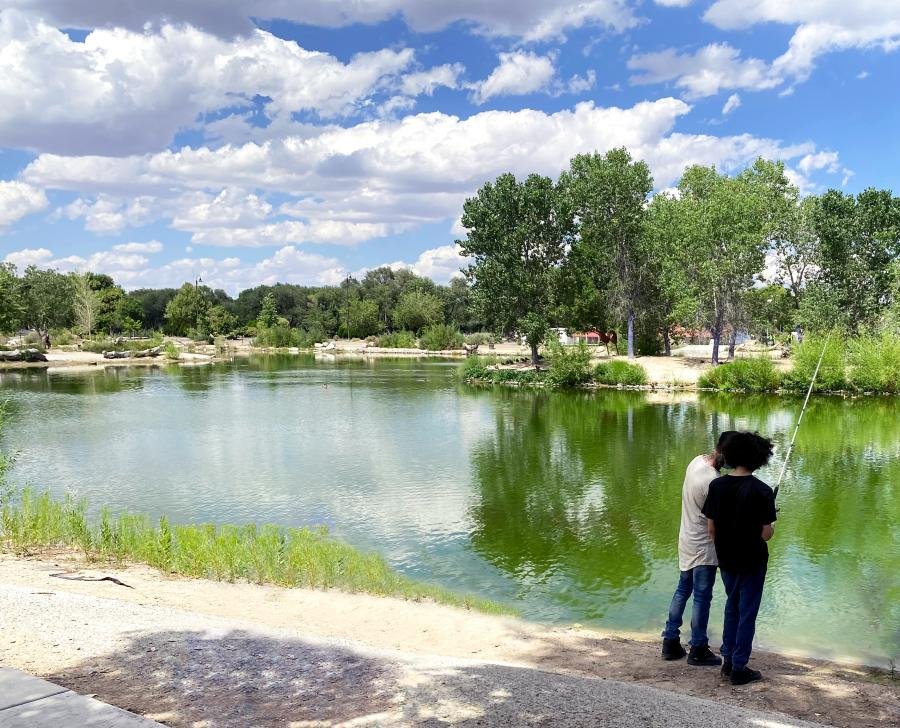 Father and son fishing at Tingley Beach, Albuquerque, New Mexico