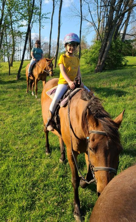 girl and woman riding horses at first farm in bed and breakfast in northern kentucky