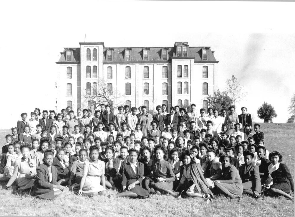Students in front of Allen Hall at Tillotson College Campus