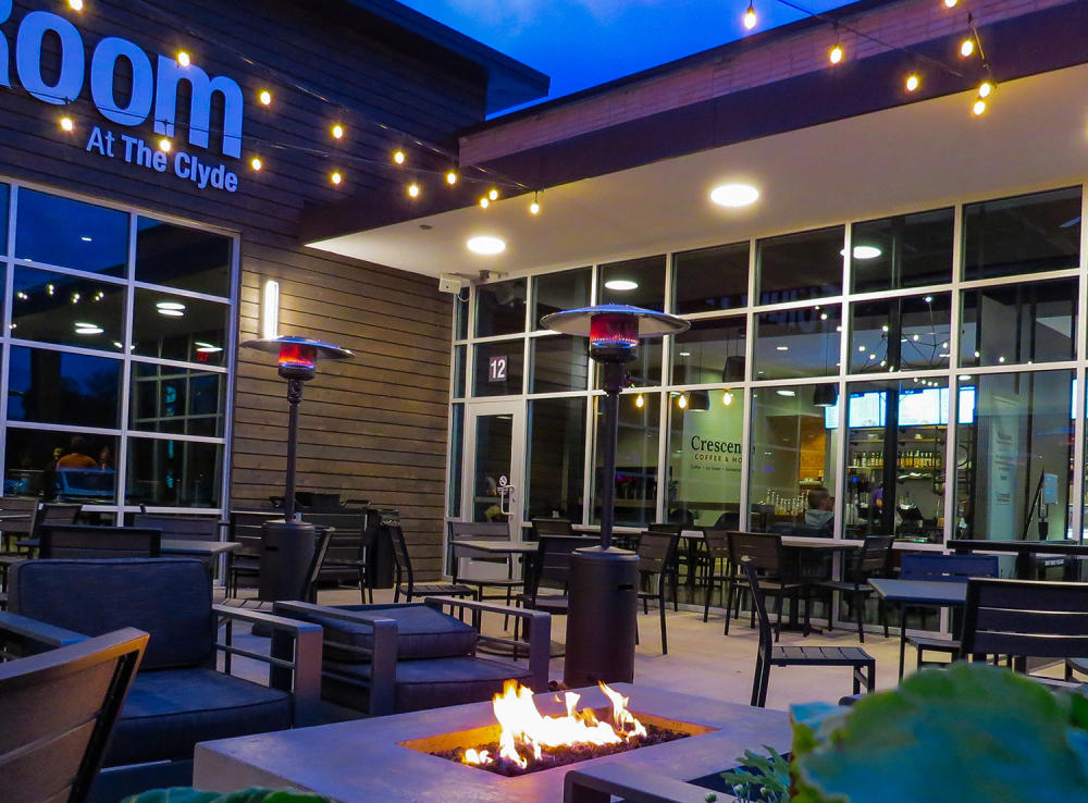 Outdoor patio with fire pits and heaters at the Clyde Club Room in Fort Wayne