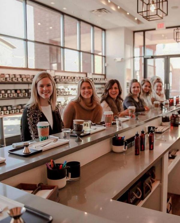 Women at the blending bar at Olfactory Scent Studio