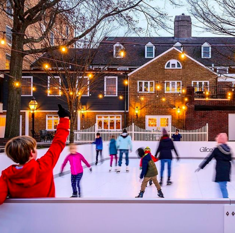 Kids and families enjoying the Palmer Square Ice Rink