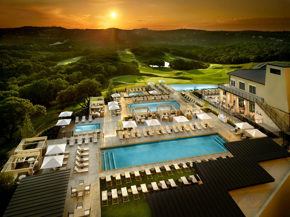 Aerial view of the pools at sunset at Omni Barton Creek Resort and Spa in Austin Texas