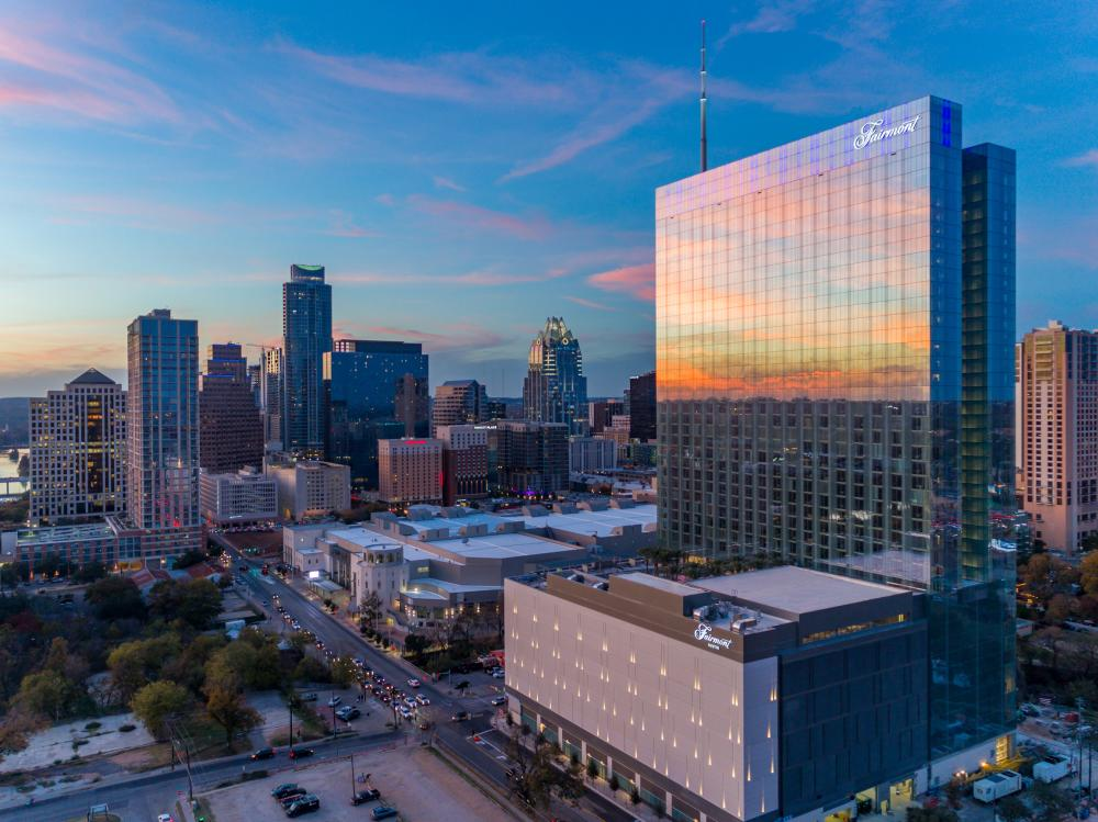 Downtown Austin Texas skyline at sunset with the Fairmont Hotel in foreground