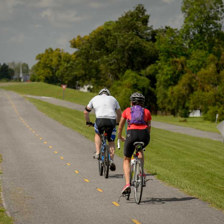 Two men riding bikes on the Levee Bike Path in Kenner, LA