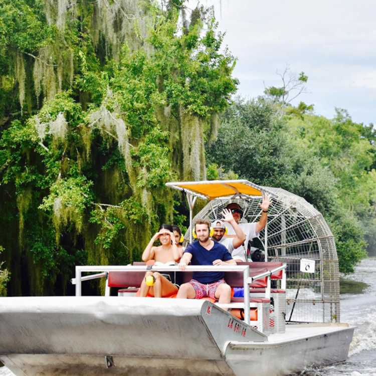 Visitors enjoy an area swamp tour aboard an airboat.