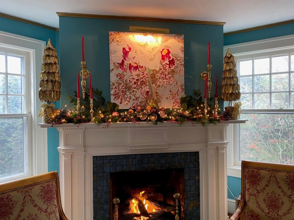 A fireplace mantle decorated for the holidays at the 1889 WhiteGate Inn in Asheville, NC