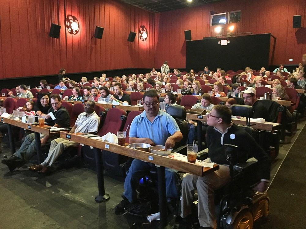 Festival goers at Alamo Drafthouse theater during Cinema Touching Disability Film Fest