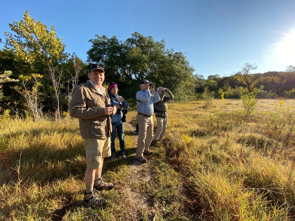 Group of people birding with binoculars at Doeskin Ranch