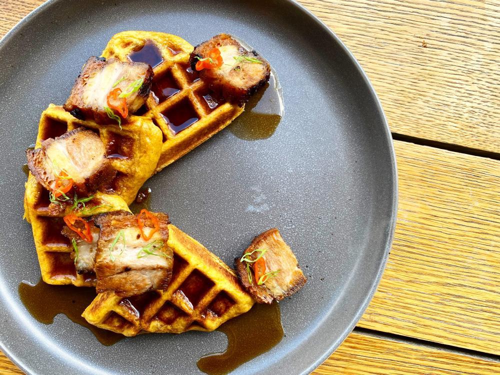 Deconstructed waffle with syrup at Biru Cocina Peruana restaurant