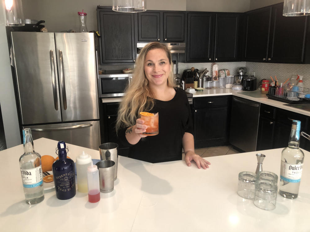 Bartender Caitlin Smith of ATX Cocina makes a cocktail at home