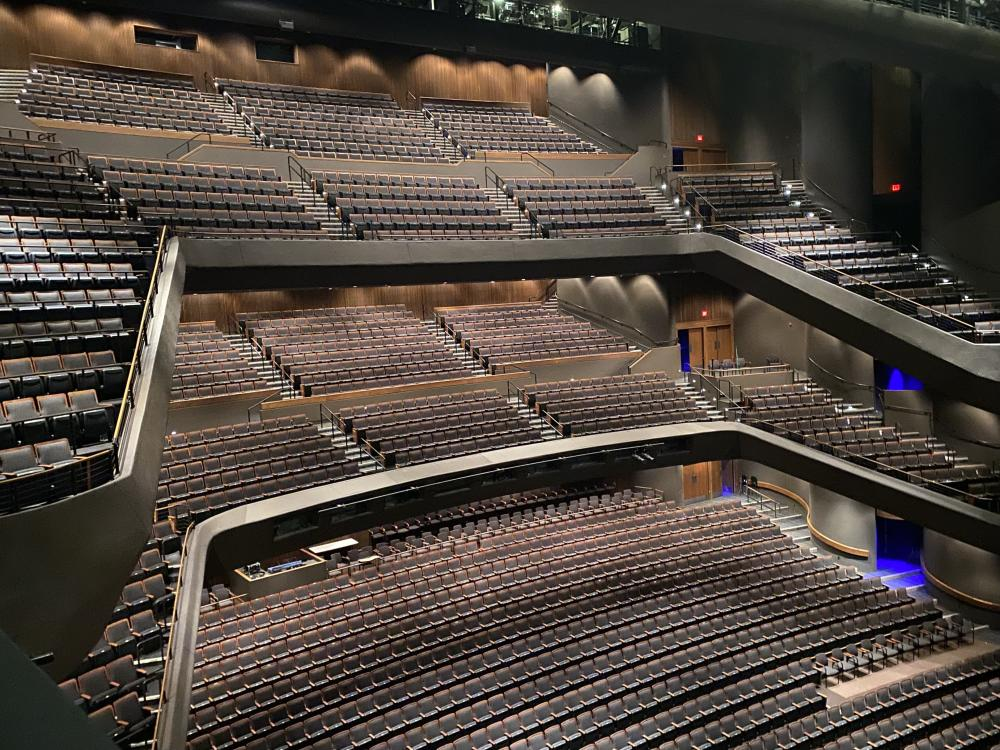 photo of the 2021 renovated interior of Bass Concert Hall. The photo shows three levels of audience seating in the concert hall