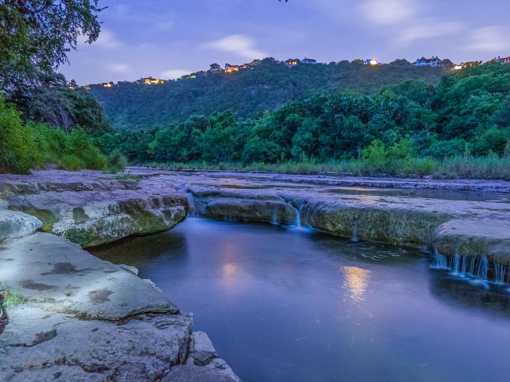 Barton Creek Greenbelt at twilight with waterfalls in the creek In Austin, TX