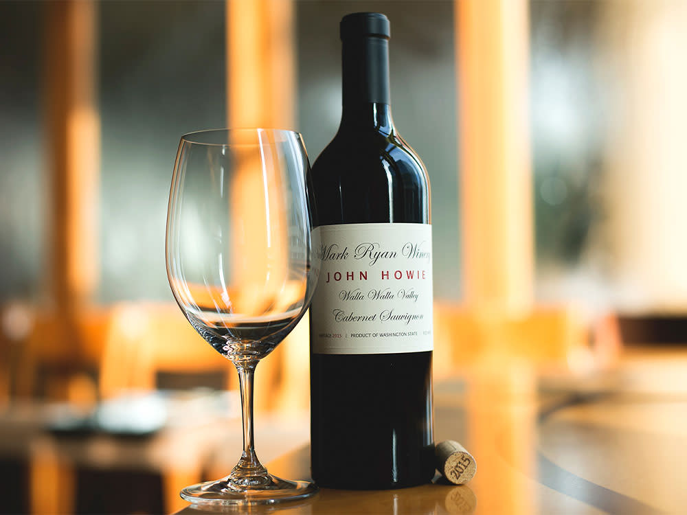 John Howie Wine Bottle And Empty Wine Glass