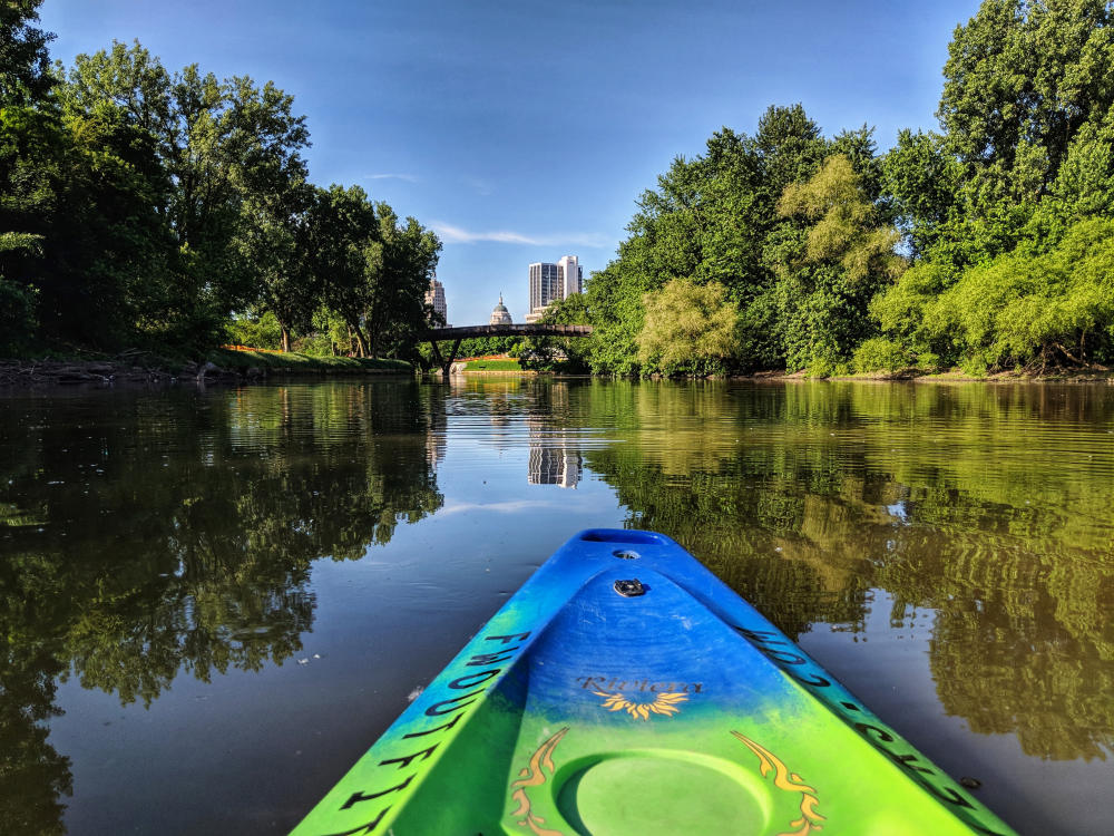 Kayaking Fort Wayne's rivers with a view of the skyline.