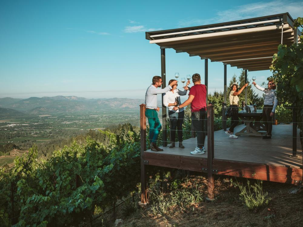 Friends enjoy wine and beautiful views at Newton Vineyard outside of St Helena.