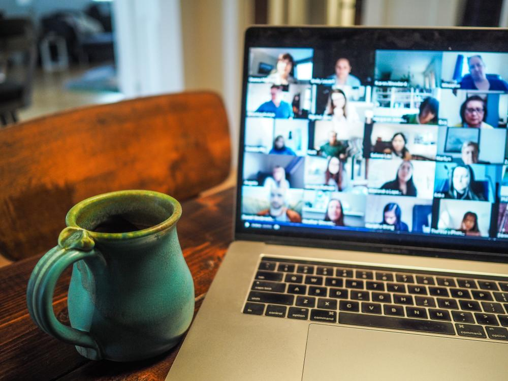 Attending virtual event through laptop from home