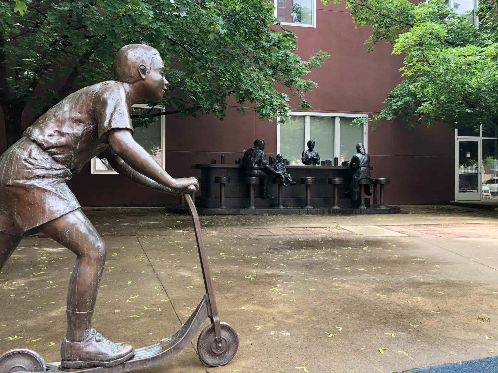Bronze Sculpture of Sit-in with Boy on Scooter