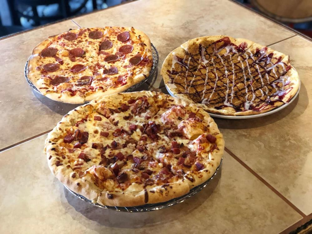 Three Pizzas from Wichita Brewing Co and Pizzeria