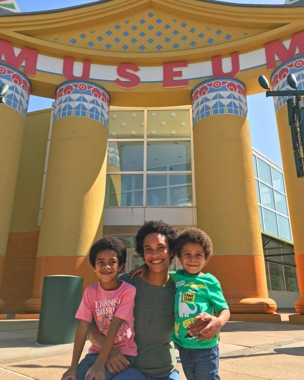 Family In Front Of The Children's Museum In Houston, TX