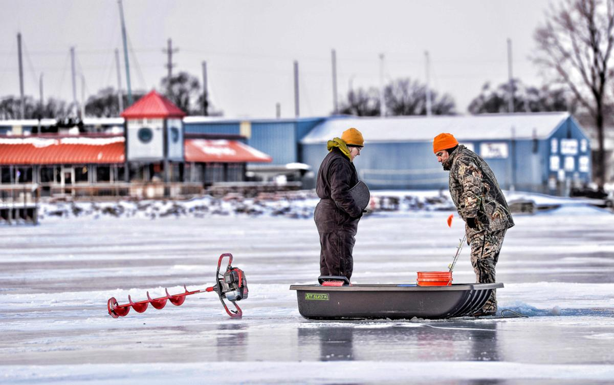 Two men ice fishing on the Saginaw River in Downtown Bay City