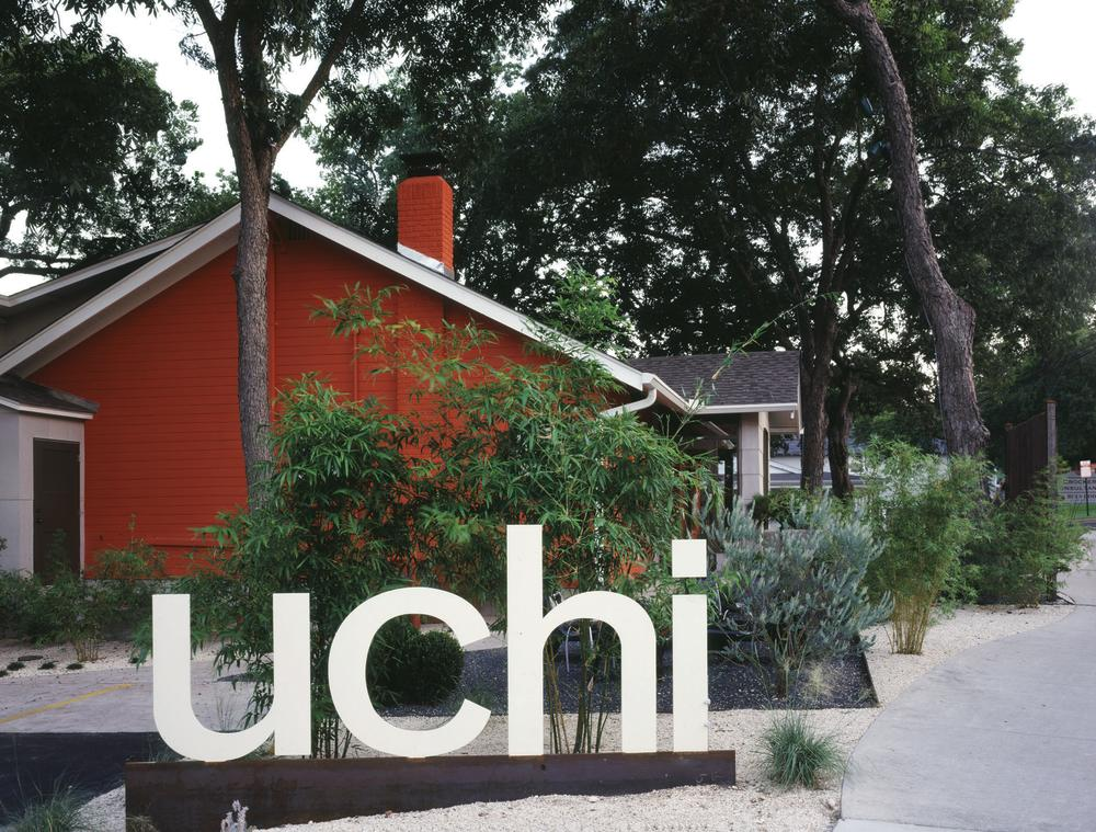 Exterior with sign reading Uchi in Austin Texas