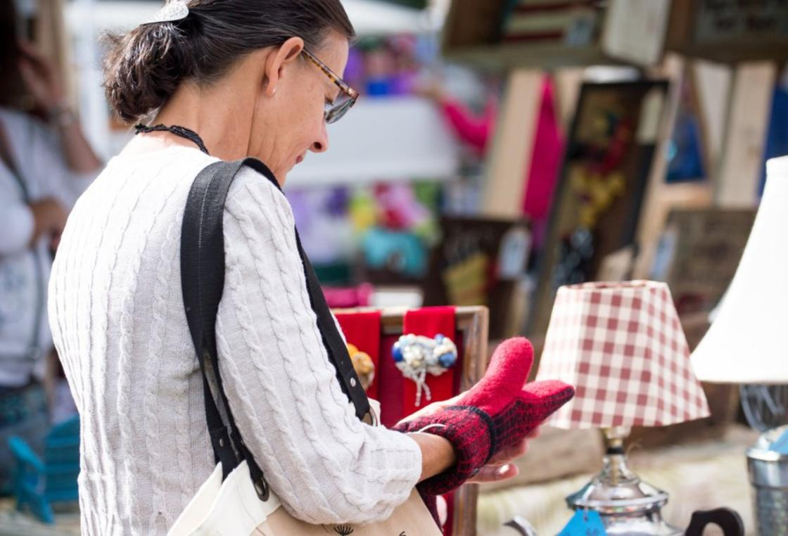 A women shops for local goods at Art in the Park at Pfiffner Pioneer Park in Stevens Point, Wisconsin.