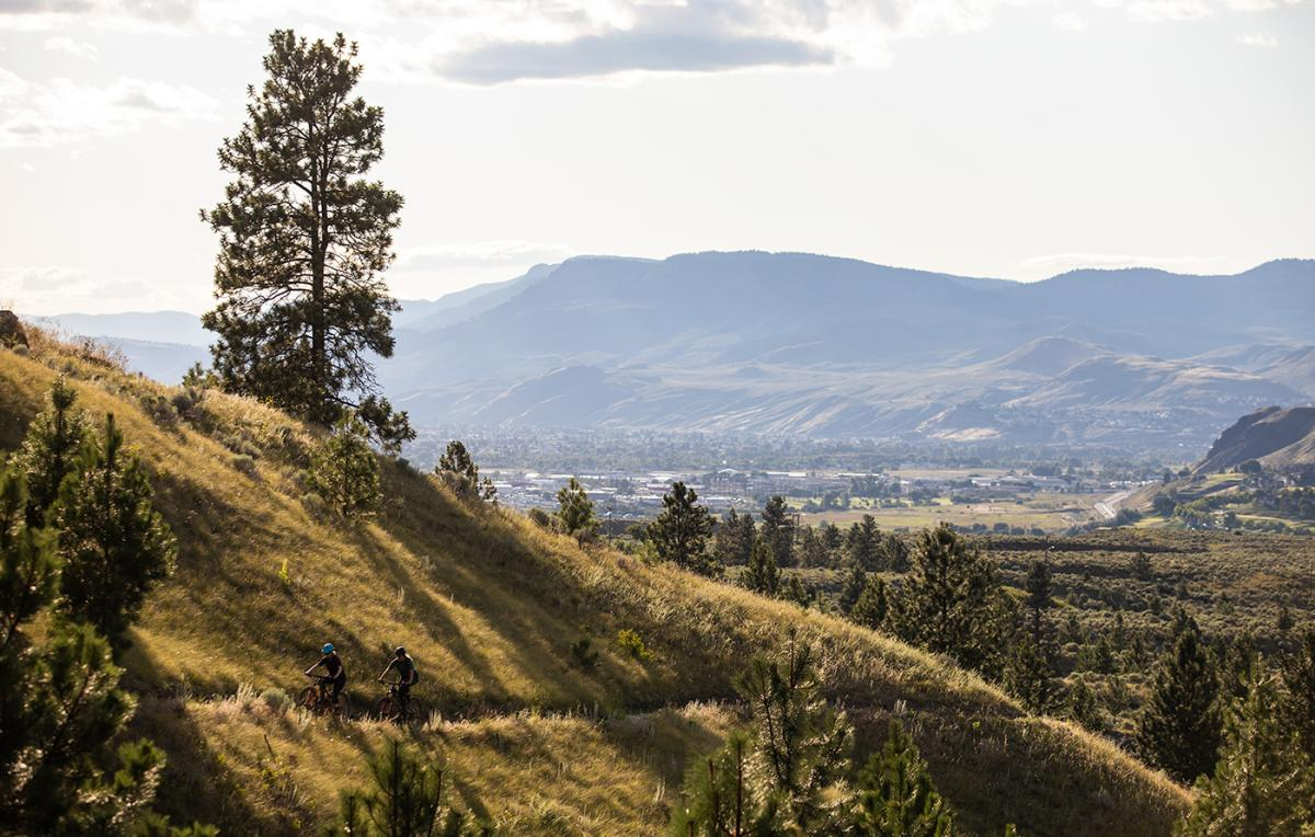 Two people mountain biking in the Kamloops Bike Ranch
