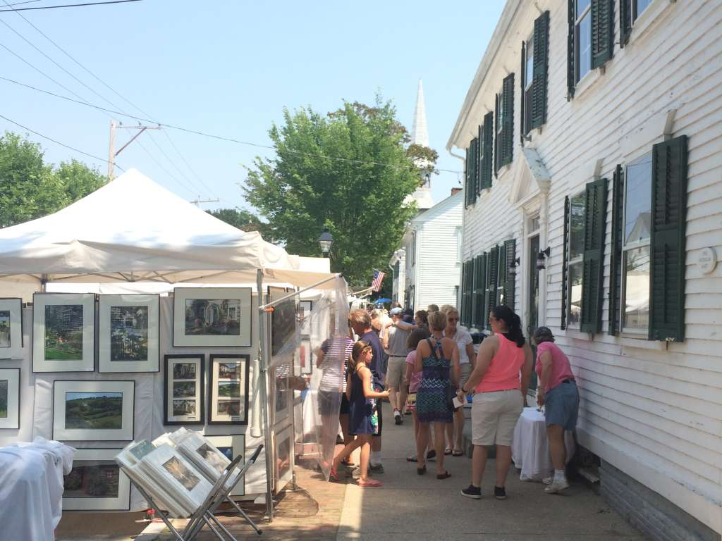 Festival goers peruse art booths at the Wickford Art Festival