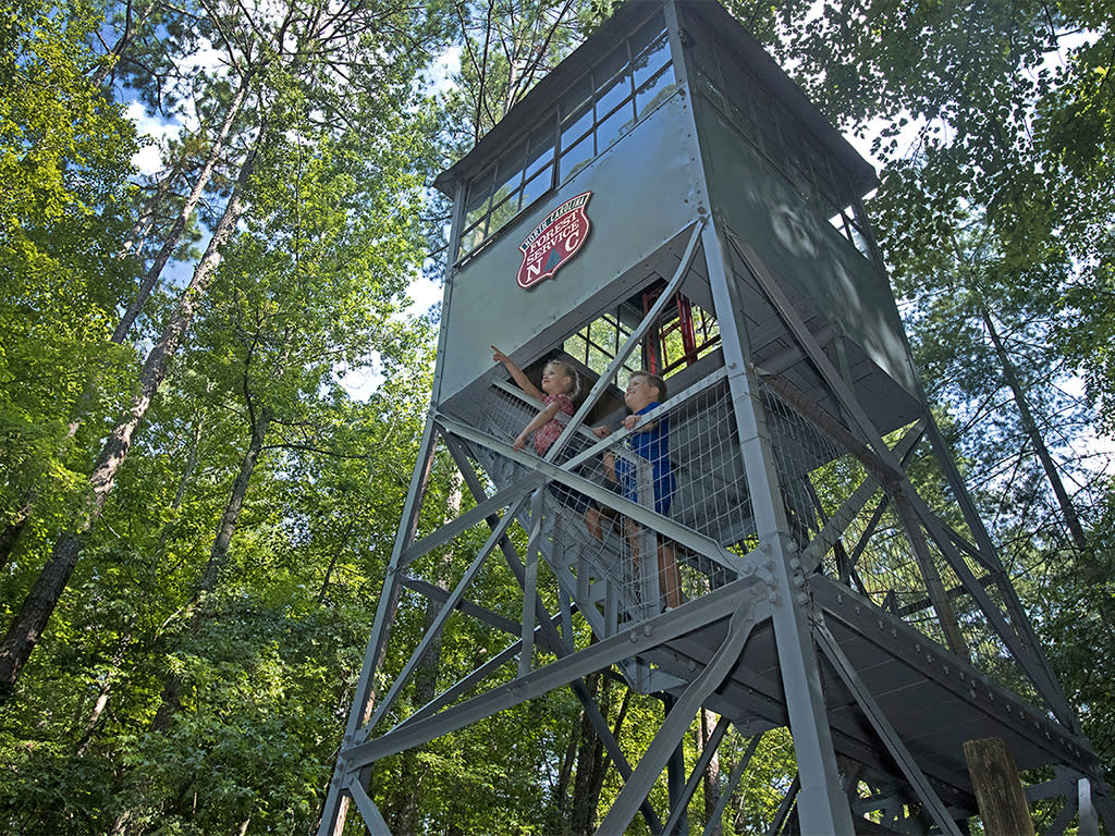 Clemmons State Forest fire tower with children, Clayton NC.