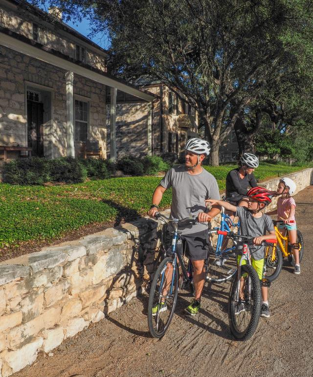 Family stopping to see the sites during their bike ride in Fredericksburg, TX