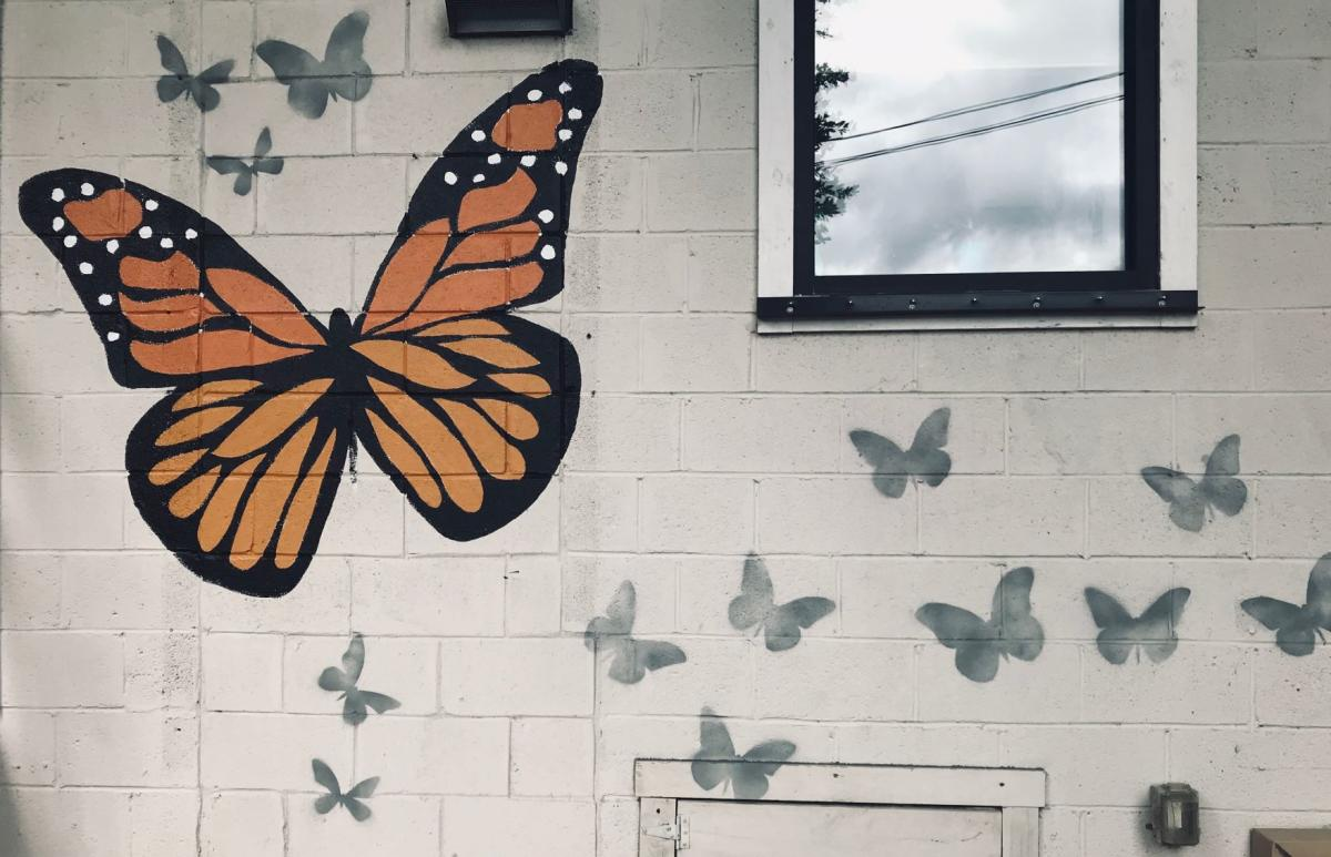 A Monarch Butterfly Mural located at  at Art in Bloom Gallery was painted by artist Fritzi Huber.