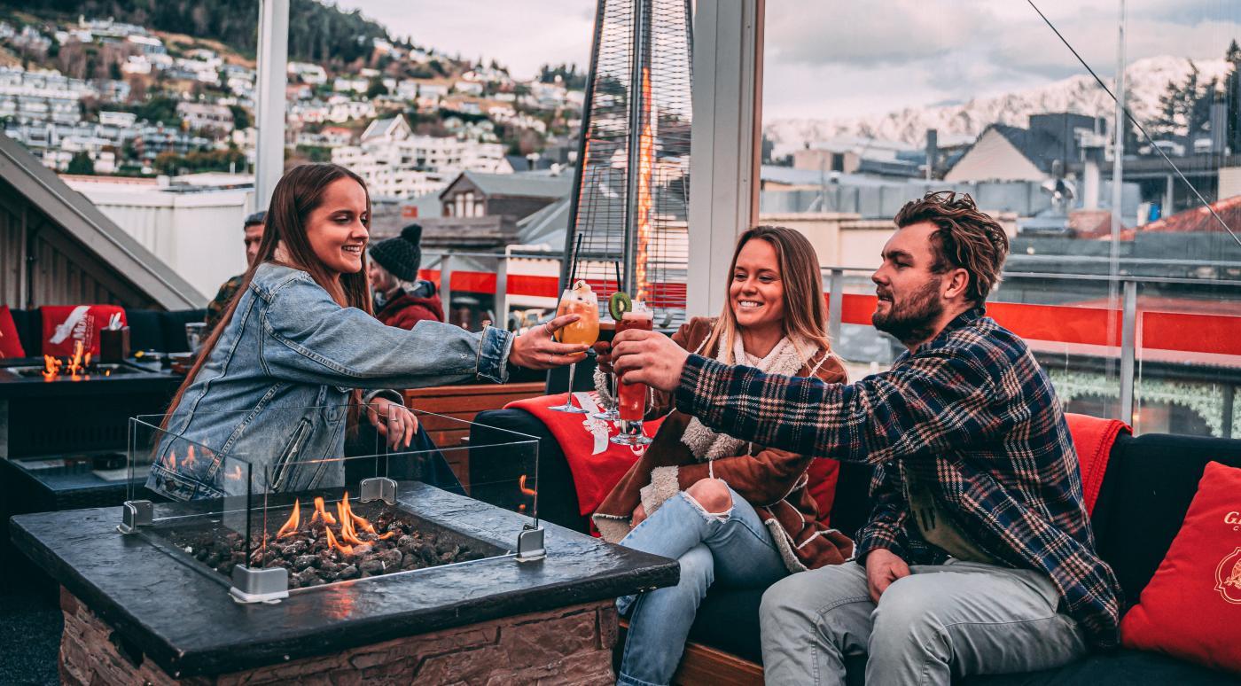 Group enjoying Apres drinks at Sundeck rooftop bar