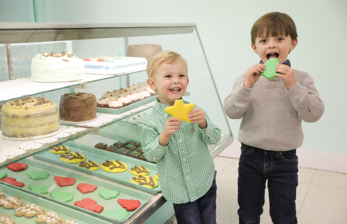 Children enjoying Christmas cookies at Ryals Bakery