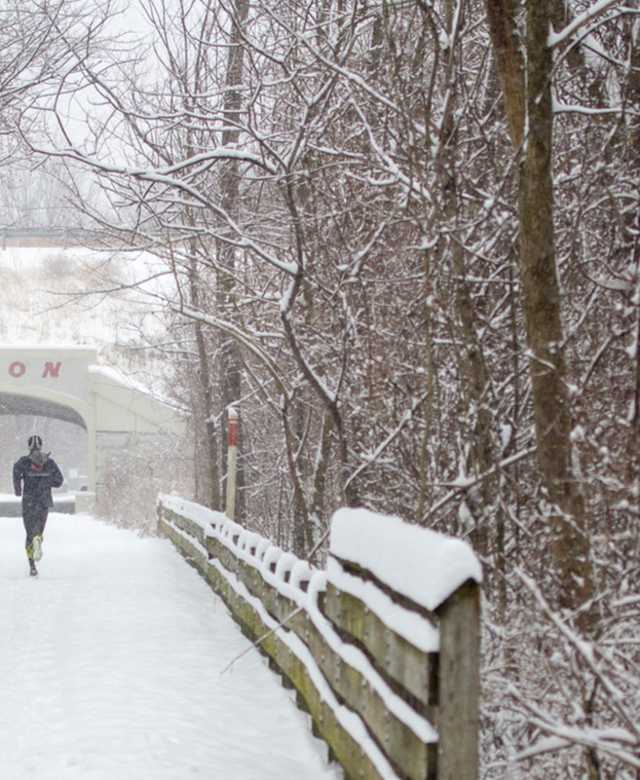 Runner on a snowy path on the Monon Trail