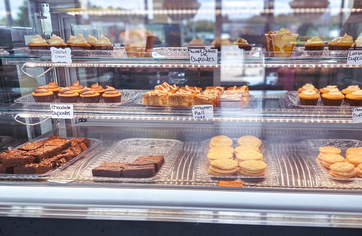 Glass case of desserts at Sweet P's Cupcakes Bakery.