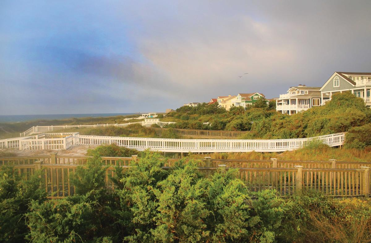 A view of oceanfront vacation rentals overlooking Wrightsville Beach, NC