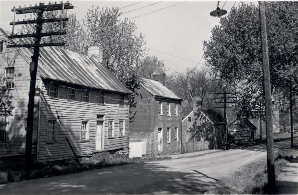 Old, 18th Century brick and wood homes line main street in Waterford, VA.